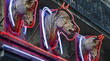 Three statues of horses' heads above a horsemeat butcher shop in Paris, Feb. 15, 2013. (Jacques Brinon/AP)