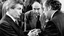 Alberta Premier Peter Lougheed, left, confers with Energy Minister Donald Macdonald and Prime Minister Pierre Trudeau before the start of the second day of the first ministers' conference in 1975 to discuss oil and natural gas prices. (The Canadian Press)