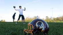 A Nepean Redskins helmet sits on the sidelines during practice on Sept. 4, 2013 in Ottawa. Ian Campeau has filed a complaint with the Ontario Human Rights Tribunal against the football club on behalf of his five-year-old daughter. (DAVE CHAN FOR THE GLOBE AND MAIL)