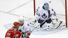 Carolina Hurricanes' Jussi Jokinen, left, gets the puck past Toronto Maple Leafs goaltender Jean-Sebastien Giguere during their NHL game in Raleigh, N.C. on Jan. 24, 2011. (ELLEN OZIER/Ellen Ozier/Reuters)
