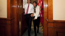 Ontario Premier Dalton McGuinty, left, walks out of the government caucus room with his wife Terri after announcing he is stepping down, in Toronto on Oct. 15, 2012. (Michelle Siu/THE CANADIAN PRESS)