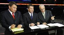 Mike Milbury, Kelly Hrudey and Scott Oake take direction from a producer during a 2010 broadcast of CBC's Hockey Night in Canada. (Jeff Vinnick for The Globe and Mail/Jeff Vinnick for The Globe and Mail)