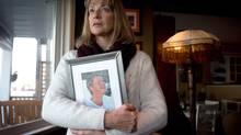 Katherine Hammond holds a photo of her 82-year-old mother Margaret Bentley as she stands for a photograph at her home in Ladner, B.C., on Tuesday February 4, 2014. Bentley has advanced Alzheimer's and her daughter lost a court battle to have a judge honour her mother's living will by ordering a stop to spoon feeding. (DARRYL DYCK/THE GLOBE AND MAIL)