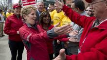 Ontario Premier Kathleen Wynne is greeted by supporters at a campaign event in Milton, Ontario on Monday May 5, 2014. (Frank Gunn/THE CANADIAN PRESS)
