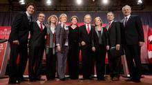 Federal Liberal leadership candidates, from left to right, Justin Trudeau, Martin Cauchon, Karen McCrimmon, Joyce Murray, Martha Hall Findlay, George Takach, Deborah Coyne, David Bertschi and Marc Garneau pose for photographs after the party's first leadership debate in Vancouver, Jan. 20, 2013. (JONATHAN HAYWARD/THE CANADIAN PRESS)