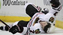 Chicago Blackhawks defenseman Brent Seabrook falls to the ice after he was checked by Anaheim Ducks defenseman James Wisniewski in the second period of an NHL hockey game in Anaheim, Calif., Wednesday, March 17, 2010. (AP Photo/Jae C. Hong) (Jae C. Hong)