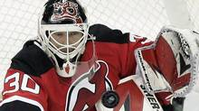 New Jersey Devils' goalie Martin Brodeur (30) makes a save on a shot from the Pittsburgh Penguins during the second period in an NHL hockey game at Prudential Center in Newark, N.J., Wednesday, Dec. 30, 2009. (AP Photo/Rich Schultz) (Rich Schultz/AP)