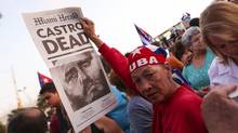 Ines Muiz, 57, holds the front page of the Miami Herald outside of the Versailles Restaurant in Miami's Little Havana on Saturday, Nov. 26, 2016, following the announcement of former Cuban leader Fidel Castro's death. The resumption of relations between Cuba and the U.S. has been welcomed by most Cubans in America because they can see their relatives more easily. (Matias J. Ocner/Miami Herald via AP) (Matias J. Ocner/AP)
