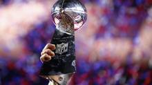 A member of the New England Patriots hoists the Vince Lombardi Trophy after defeating the Seattle Seahawks in Super Bowl XLIX (Mark J. Rebilas/USA Today Sports)