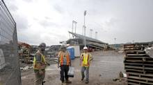 Construction workers leave the CIBC Hamilton Pan Am Stadium in Hamilton, June 24, 2014. (J.P. Moczulski for The Globe and Mail) (J.P. MOCZULSKI for the globe and mail)