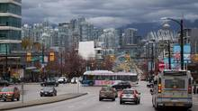 A TransLink bus travels on West Broadway in Vancouver, B.C., on Wednesday March 22, 2017. (DARRYL DYCK For The Globe and Mail)
