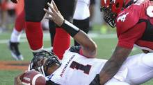 Calgary Stampeders' Charleston Hughes sacks Ottawa Redblacks' quarterback Henry Burris (1) in the second half of a CFL game in Calgary, Alberta, August 9, 2014. (MIKE STURK/REUTERS)