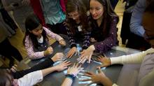 Girls at the one-day event worked with female mentors to encourage them to consider careers in science and technology. (Peter Power/The Globe and Mail)