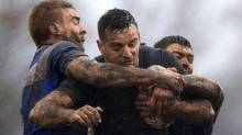 Siddal's Sean Garrod, left, and Ben Hinsley tackle Toronto Wolfpack's Craig Hall, center, during the Ladbrokes Challenge Cup match at Siddal ARLFC, Halifax, England, Saturday Feb. 25, 2017. (Clint Hughes/THE CANADIAN PRESS)