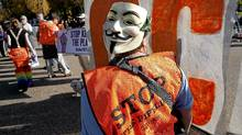 A demonstrator wearing a Guy Fawkes mask on the back of her head, calls for the cancellation of the Keystone XL pipeline during a rally in front of the White House in Washington November 6, 2011. (JOSHUA ROBERTS/JOSHUA ROBERTS/REUTERS)