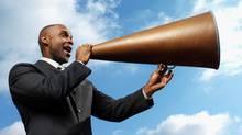 businessman talking through megaphone, low angle view (George Doyle/(c) George Doyle)