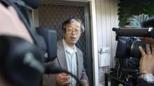 A man widely believed to be Bitcoin currency founder Satoshi Nakamoto is surrounded by reporters as he leaves his home in Temple City, Calif., March 6, 2014. (DAVID MCNEW/REUTERS)