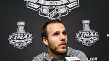 Boston Bruins centre David Krejci answers a question during a news conference for the NHL Stanley Cup finals to be played against the Chicago Blackhawks in Chicago, June 11, 2013. The Stanley Cup finals start June 12. (JEFF HAYNES/REUTERS)