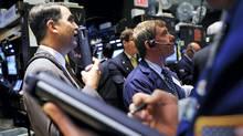 Traders work on the floor of the New York Stock Exchange (SHANNON STAPLETON)