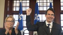 Quebec Premier Pauline Marois and Pierre Karl Péladeau at a press conference. (GRAHAM HUGHES/THE CANADIAN PRESS)