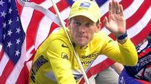 FILE - This July 23, 2000 file photo shows Tour de France winner Lance Armstrong riding down the Champs Elysees with an American flag after the 21st and final stage of the cycling race in Paris. The superstar cyclist, whose stirring victories after his comeback from cancer helped him transcend sports, chose not to pursue arbitration in the drug case brought against him by the U.S. Anti-Doping Agency. That was his last option in his bitter fight with USADA and his decision set the stage for the titles to be stripped and his name to be all but wiped from the record books of the sport he once ruled. (LAURENT REBOURS/AP)