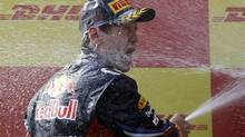 Red Bull Formula One driver Sebastian Vettel of Germany celebrates on the podium (LEONHARD FOEGER/REUTERS)