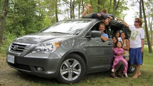 John Heinzl, in the driver's seat, wanted to test to the Honda Odyssey's limits, so he took his family and his sister-in-law's family on a road trip.