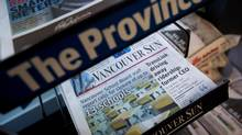 Postmedia cut about 90 jobs and merged newsrooms in four cities as it steps up plans to slash costs amid mounting revenue losses. (DARRYL DYCK/THE CANADIAN PRESS)