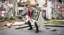 Beau Dick conducts a ceremonial first nation prayer and dance in front of the St. Michael's Residential School in Alert Bay February 18, 2015 after a symbolic decommission and demolition of the former residential school. (John Lehmann/The Globe and Mail)