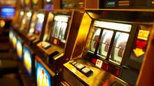 Row of slot machines (Jupiterimages/Getty Images)