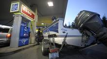 A motorist fills up at a Toronto gas station. (Fred Lum/Fred Lum/The Globe and Mail)