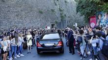 People crowd around as guests arrive in cars at Fort Belvedere, the venue where television personality Kim Kardashian and rapper Kanye West will celebrate their wedding, in Florence May 24, 2014. (ALESSANDRO GAROFALO/REUTERS)