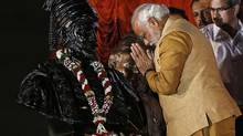 Hindu nationalist Narendra Modi, prime ministerial candidate for the main opposition Bharatiya Janata Party (BJP), gestures at the statue of Chhatrapati Shivaji, revered by many in western India as a Hindu warrior king, during an election campaign rally in Mumbai on April 21, 2014. (DANISH SIDDIQUI/REUTERS)