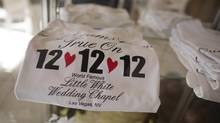 T-shirts advertising the 12-12-12 date sit on display at A Little White Wedding Chapel in Las Vegas. (Julie Jacobson/AP)