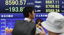 An electronic stock board in Tokyo. Canadian executives are keeping a wary eye on global economic turmoil. AP Photo/Shizuo Kambayashi (Shizuo Kambayashi/AP)