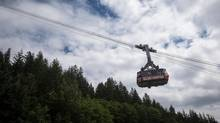 The Grouse Mountain Skyride cable car shuttles visitors from the top of the mountain in North Vancouver, B.C., on Wednesday, July 12, 2017. (DARRYL DYCK/THE GLOBE AND MAIL)