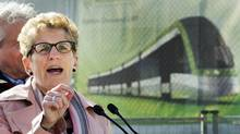 Liberal Leader Kathleen Wynne speaks to the media during a campaign stop at the construction site of the Eglinton LRT on Eglinton Ave. West in Toronto on Tuesday, May 6, 2014. (Nathan Denette/THE CANADIAN PRESS)
