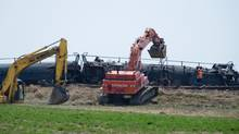 Crews work to clean up five Canadian Pacific Railway Ltd. tankers containing oils that derailed near Jansen, Sask., on May 21, 2013. (LIAM RICHARDS/THE CANADIAN PRESS)