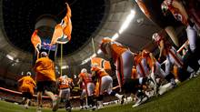 B.C Lions players take to the field after the roof was opened at the renovated B.C. Place stadium before the Lions and Edmonton Eskimos CFL football game in Vancouver, B.C., on Friday September 30, 2011. The stadium was closed for 18-months to undergo a $563-million renovation which included a new retractable fabric roof. THE CANADIAN PRESS/Darryl Dyck (DARRYL DYCK)