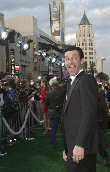 Why looky here, it's Jon Hamm! Looking good at the L.A. premiere of the new Disney movie Million Dollar Arm, which he desperately hopes will make the public forget all about Mad Men and accept him as a genuine movie star. (MARIO ANZUONI/REUTERS)
