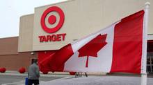 A Canadian flag flies on the car of a customer's car parked in front of a Target store in Guelph, Ont., in 2013. (Dave Chidley/Canadian Press)