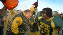 Mayor Rob Ford gets a Gatorade bath as his Don Bosco Eagles celebrate their 31-0 victory over the Northern Red Knights in the Metro Bowl qualifier played at Birchmount Stadium in Toronto on Nov. 15, 2012. (Peter Power/The Globe and Mail)