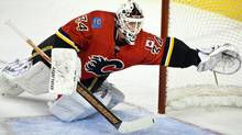 Calgary Flames goalie Miikka Kiprusoff, from Finland, dives across the crease to try and stop a goal during second period pre-season NHL hockey action in Calgary, Alta., Sunday, Sept. 25, 2011.THE CANADIAN PRESS/Jeff McIntosh (Jeff McIntosh/CP)