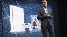 Andrew House, President and Group Chief Executive Officer of Sony Computer Entertainment, presents a white PlayStation 4 during a media briefing before the opening day of the Electronic Entertainment Expo, or E3, at the Memorial Sports Arena in Los Angeles, California June 9, 2014. REUTERS/Mario Anzuoni (UNITED STATES - Tags: SCIENCE TECHNOLOGY BUSINESS SOCIETY) (MARIO ANZUONI/REUTERS)