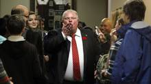 Toronto Mayor Rob Ford blows a kiss to the media while touring City Hall with a group of kids during the annual Take Your Kid to Work Day at City Hall, Toronto November 06, 2013. (Fernando Morales//The Globe and Mail.)