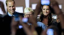 In this July 10, 2011, file photo, Prince William and wife Kate, the Duke and Duchess of Cambridge, are photographed by fans during a visit to the U.S. in Culver City, Calif. The palace announced Monday, Dec. 3, 2012, that Prince William and wife Kate are expecting their first child. (Chris Pizzello/AP)