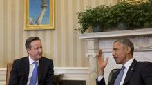 In the wake of the horrific Paris attacks, British Prime Minister David Cameron, left, and U.S. President Barack Obama met in Washington last week to discuss digital security and surveillance. (STEPHEN CROWLEY/NYT)