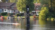 The 5.5-metre-tall Pipe Man sits in the Muskoka River in Huntsville, Ont. A survey found just 9 per cent of respondents like the artwork, while 60 per cent give it thumbs down, many condemning it as an eyesore and free advertising for the local company that donated it. (Dawn Huddlestone/Huntsville Doppler)