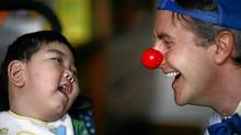Jamie Burnett, a therapeutic clown at Bloorview Kids Rehab, performs his character Ricky the clown in front of 2-year-old Johnni Lin who suffers complex medical problems related to Meningitis. Fernando Morales/The Globe and Mail (Fernando Morales/The Globe and Mail)