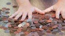 hands of little girl counting coins (Alex Potemkin)